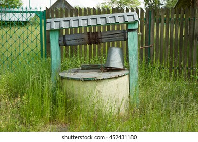 A well and a tin bucket