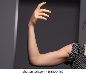 Well toned arm forearm hand of a young white woman. Healthy body part concept