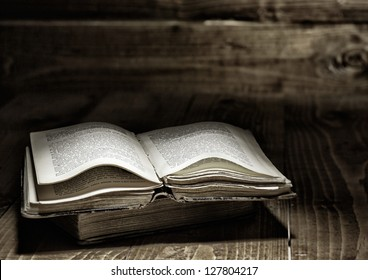 Well used open book on wooden table