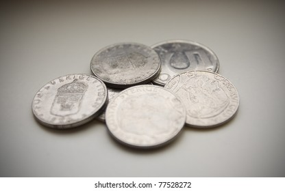 Well used Swedish coins on gray background.. SHORT DOF and Vignetted
