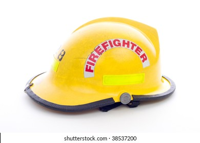 A well used Yellow Fire Fighters Helmet on White
