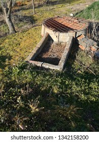 Well of water for the irrigation of the field of the center of the Iberian Peninsula. Irrigation system from shallow underground aquifer. Fruit trees. Agricultural equipment and infrastructure.