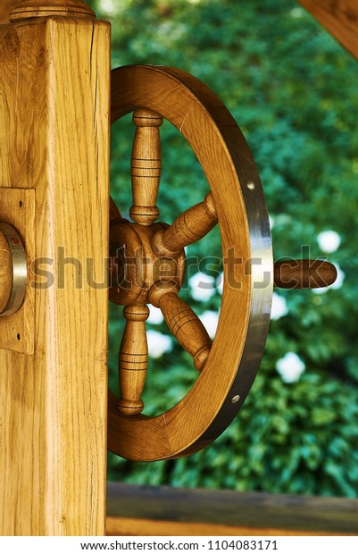well wooden wheel on a green background