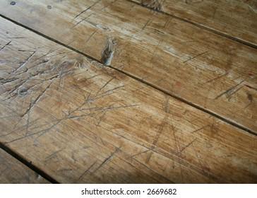 well worn farmhouse table top