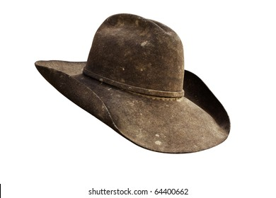Well worn leather cowboy hat with all grunge intact. Work path.