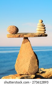 Well-balanced of pebbles on the top of stone