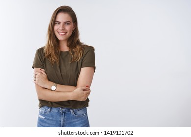Wellbeing people lifestyle concept. Charming feminine tender outgoing young woman wearing olive t-shirt cross arms chest smiling cute flirty expressing positivity joyful attitude, white background