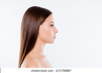 Wellbeing wellness beauty health concept. Side view profile portrait with copy space of charming pretty girl with fresh hair and skin isolated on white background