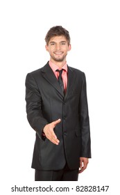 Well-dressed attractive young business man is giving a handshake stand with an open hand ready to seal a deal, isolated over white background