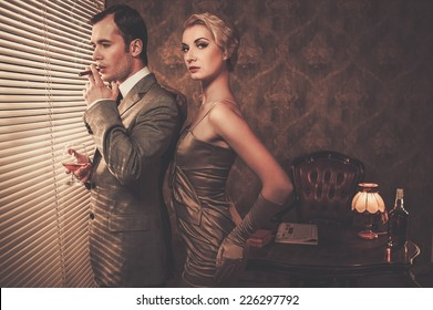 Well-dressed retro style couple near window