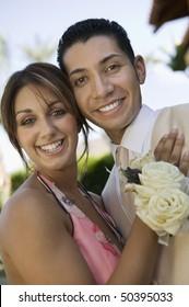 Well-dressed teenage couple outside school dance, portrait
