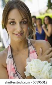 Well-dressed teenage girl outside school dance, portrait
