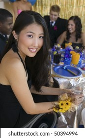 Well-dressed teenager girl sitting at school dance