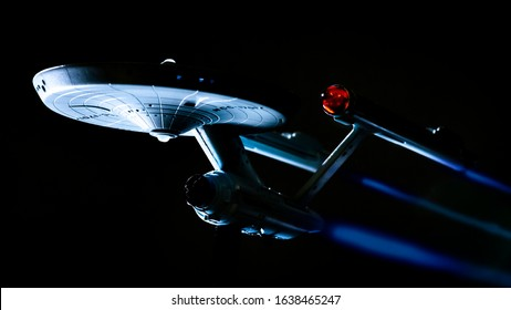 Wellesbourne, Warwick/England UK - 02.06.2020: A model of the Starship Enterprise from the TV series Star Trek dramatically lit from below against a black background to replicate space.