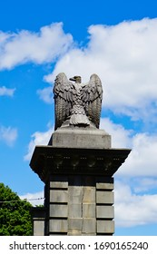 Wellesley, Massachusetts/United States-6/20/2019: eagle sculpture on stone column of old stone gate of Wellesley college on Main Street