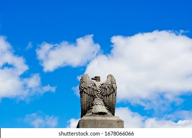 Wellesley, Massachusetts/United States-6/20/2019: stone sculpture of American eagle on the top of historic stone gate of Wellesley college on Main Street