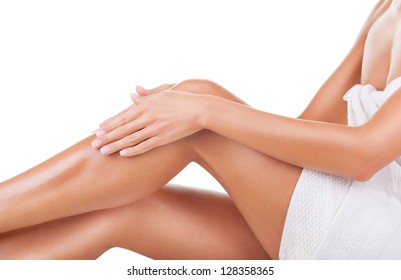 Well-groomed female legs after depilation isolated on white background