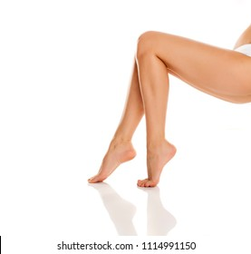 well-groomed woman's legs on white background