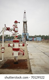 Wellhead against the rig in oifield