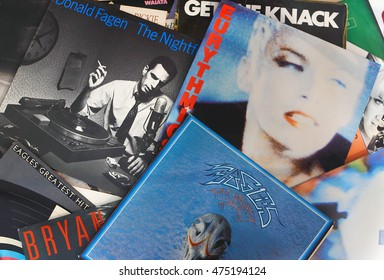 WELLINGTON, FLORIDA - August 28, 2016: Scattered record album covers of popular musical artists from the 1970's and 1980's featuring The Eurythmics, Donald Fagan and The Eagles albums.