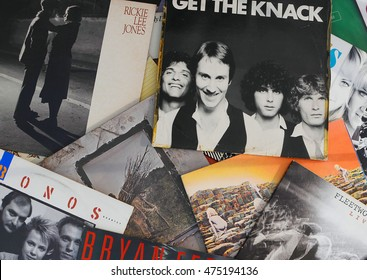 WELLINGTON, FLORIDA - August 28, 2016: Scattered record album covers of popular musical artists from the 1970's and 1980's featuring The Knack, Led Zeppelin and Kronos Quartet albums