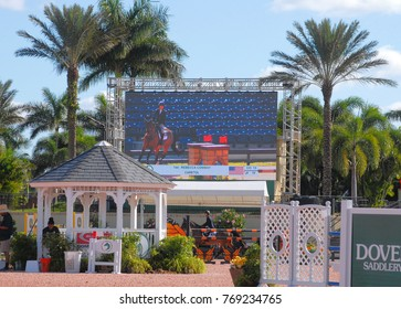 WELLINGTON, FLORIDA - DECEMBER 2, 2017: Rebecca Conway and Caretol shown on the jumbotron at the Holidays and Horses event by Equestrian Sports Productions in Wellington, Florida.
