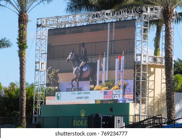 WELLINGTON, FLORIDA - DECEMBER 2, 2017: Jimmy Torano and Johnny Cahs on the jumbotron at the Holidays and Horses event by Equestrian Sports Productions in Wellington, Florida.