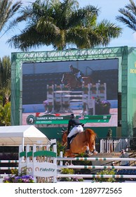 WELLINGTON, FLORIDA - January 16, 2019: Tanner Korotkin and Goldbreaker in front on the jumbotron at WEF 2 Netjets USEF AA/CSI 2 in Wellington, Florida