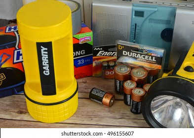 WELLINGTON, FLORIDA - October 8, 2016. Illustrative editorial mixture of items to for a hurricane or other emergency event, including batteries, a radio, flashlights, duct tape and plastic