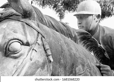 Wellington, Florida/USA - February 26, 2020: A horizontal black and white closeup image of a horse and rider sculpture in Palm Beach County, Florida.