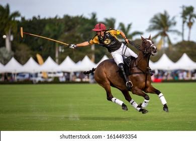 Wellington, Florida/USA - January 12, 2020: Joe Barry Cup Final at International Polo Club. Polo jockeys on horseback playing on the 300 yards long field.
