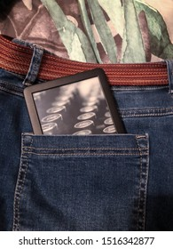 Wellington, New Zealand, 20 July 2019: amazon kindle fits into back pocket of jeans - concept