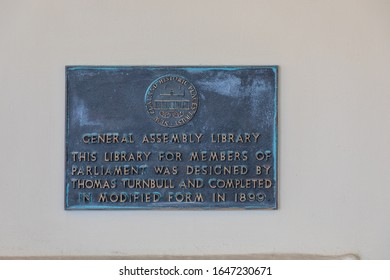 Wellington, New Zealand - 28 December 2019: Dedication plaque of the New Zealand Parliamentary Library,  designed in Gothic revival style and completed in 1899.