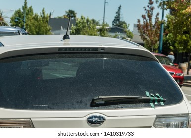 Wellington, New Zealand - Jan 2019: Broken wind screen wipers taped to car window. Funny concept