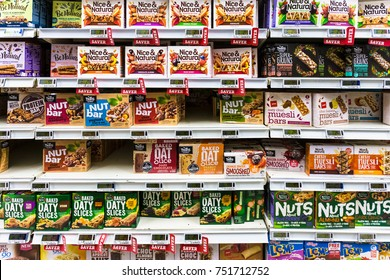 WELLINGTON, NEW ZEALAND - MARCH 1, 2017: Various cereal and nuts bars are displayed in a supermarket in Wellingtion in New Zealand capital city.