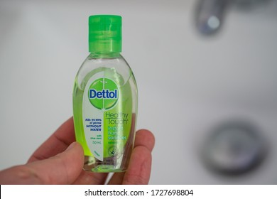 Wellington / New Zealand - May 11 2020: hands holding a Small bottle of Dettol hand sanitizer