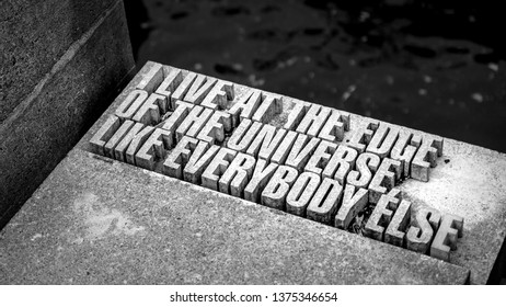 """WELLINGTON, NEW ZEALAND - May 24, 2018: Stone poetry with text, """"I live at the edge of the universe like everybody else."""""""