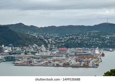Wellington / New Zealand - May 28 2019: Remote view of Wellington container port with houses and hills behind
