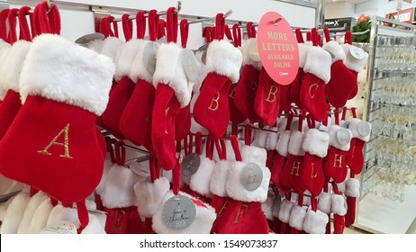 WELLINGTON, NEW ZEALAND - OCTOBER 26, 2019: Many capital letter Santa Claus stocking or stocking stuffers selection for Christmas decoration hanging on display shelves at Farmer department store.