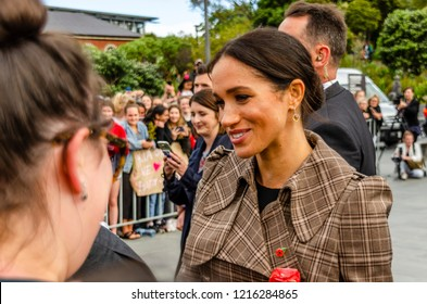 Wellington, New Zealand - October 28, 2018: The Duchess of Sussex chats with a member of the crowd at the Wellington War Memorial in New Zealand.