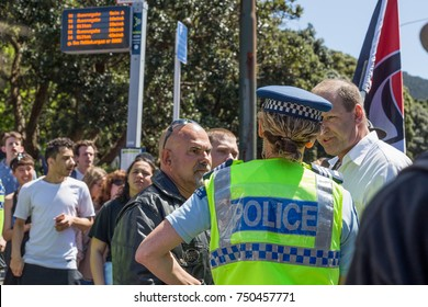 Wellington, New Zealand - October 28, 2017: National Front members made their way to Parliament against Protesters for inclusion and diversity hosted by Migrant & Refugee Rights Campaign.