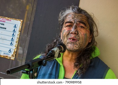 Wellington, North Island / New Zealand - June 1st 2017: Maori man with Ta Moko busking in Wellington