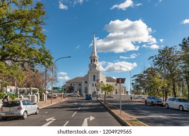WELLINGTON, SOUTH AFRICA, AUGUST 8, 2018: A street scene, with the Dutch Reformed Mother Church, people and vehicles, in Wellington in the Western Cape Province
