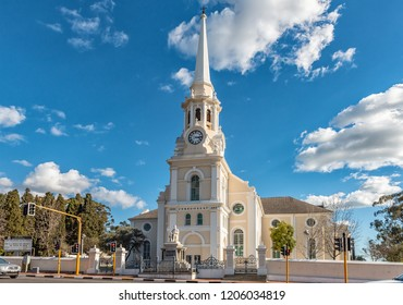 WELLINGTON, SOUTH AFRICA, AUGUST 8, 2018: A street scene, with the Dutch Reformed Mother Church, in Wellington in the Western Cape Province. A statue of reverent Andrew Murray is visible