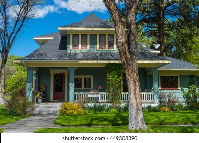 Well-kept older classic vintage American house with porch