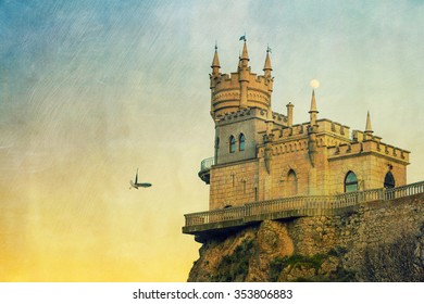 The well-known Crimean castle Swallow's Nest with moon and bird, vintage postcard style