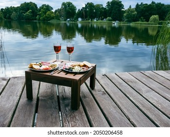 well-laid dinner table at a small lake