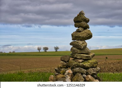 Well-maintained cairn in open farmland in the Tarn in Southern France