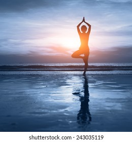 wellness concept, beautiful silhouette of woman practicing yoga