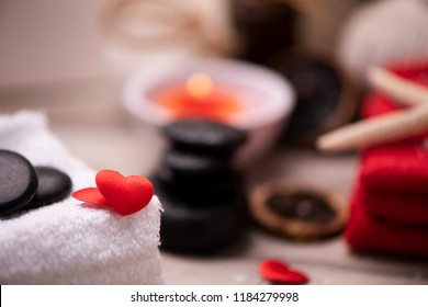 Wellness docoration on valentine's day with candels and stones